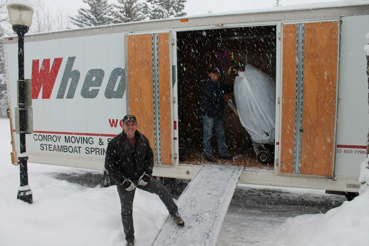 Owner Scott Lewer, left, and Charlie Conroy, of Conroy Moving & Storage, moved the Tread of Pioneers Museum's Christmas trees to various businesses in the Steamboat Springs area to promote charity and the Christmas spirit as part of the Festival of Trees. Conroy Moving & Storage has been volunteering the service for more than 20 years.