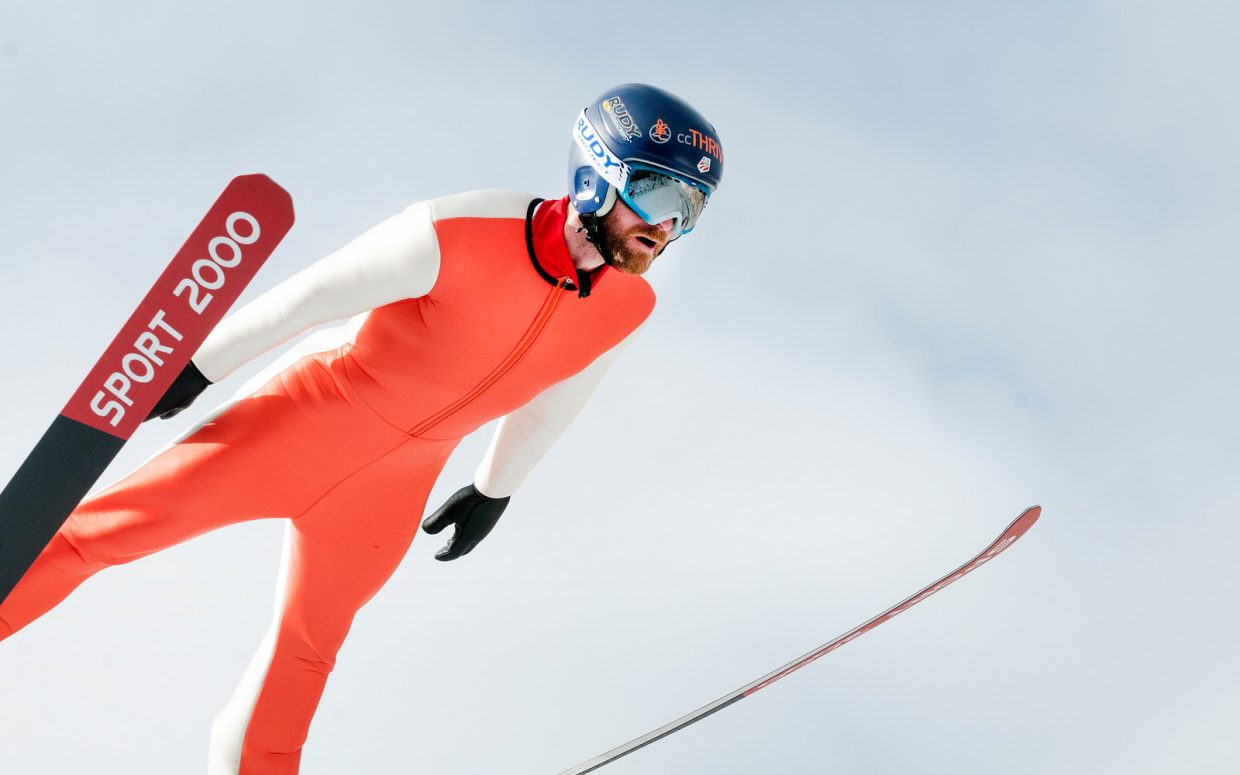 U.S. Nordic combined Ski Team member Bryan Fletcher jumps in Park City, Utah earlier this month as the team worked through one of its last training sessions in the United States. The squad begins competition in the World Cup season starting on Saturday in Finland.