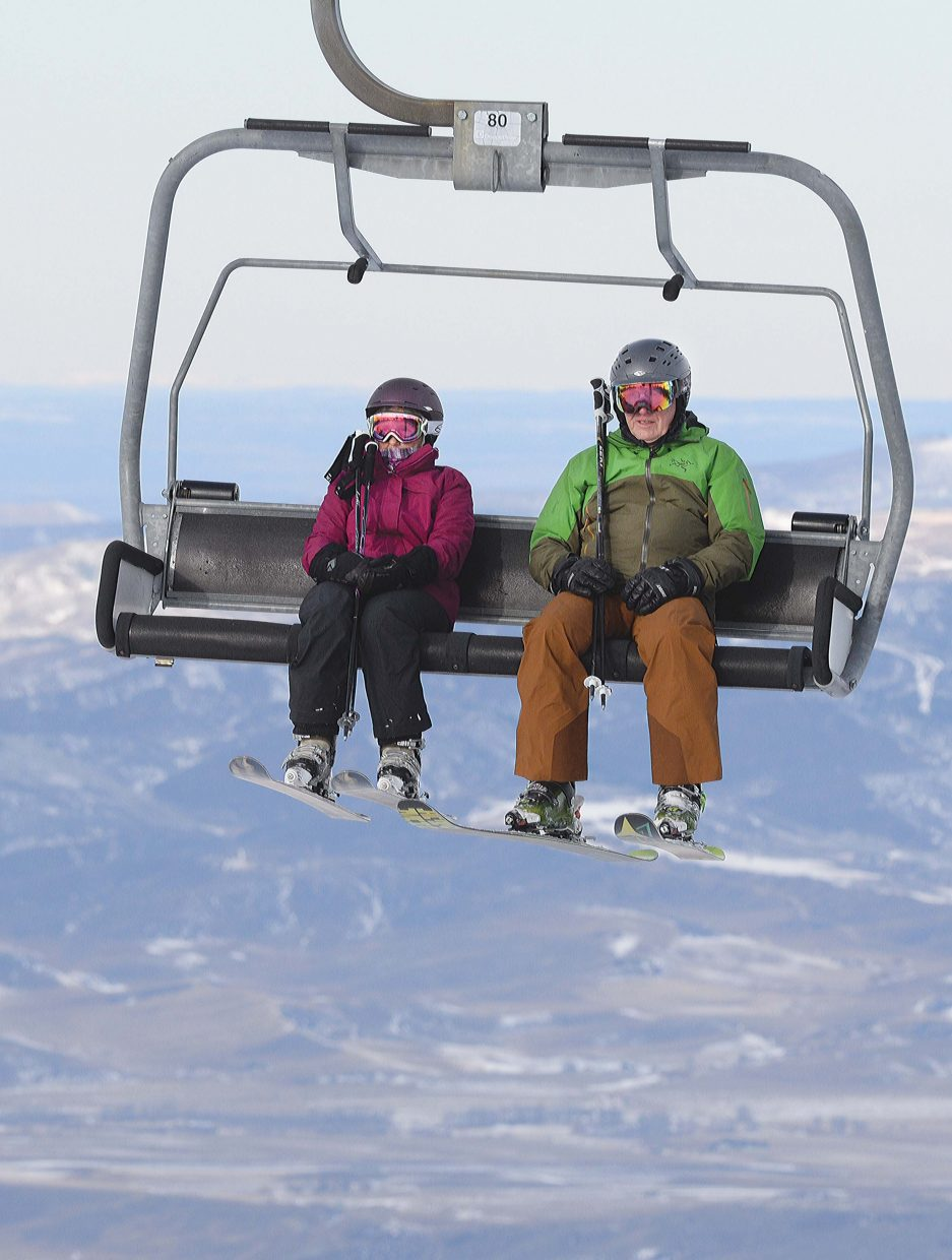 Skiers Charlie Pharris, right, and Karen Pharris make their way up the Storm Peak Express during the 2015 Scholarship Day at the Steamboat Springs Ski Area.