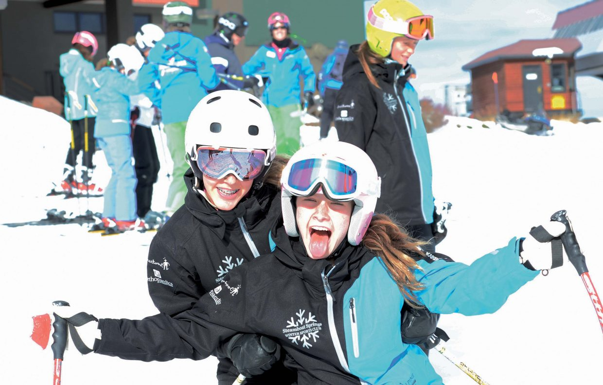 Kenzie Radway, back, and Emily Schneider are all smiles Wednesday during Scholarship Day at the Steamboat Springs Ski Area. The annual fundraiser for the Steamboat Springs Winter Sports Club marks the start of the season. The proceeds raised from the sale of lift tickets are donated to the Steamboat Springs Winter Sports Club's scholarship program.