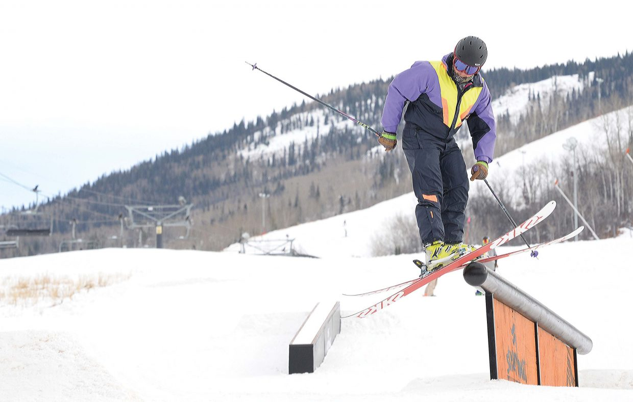 Skier Dean Domingue rides a rail at the bottom of the Steamboat Ski Area Wednesday during Scholarship Day. The annual fundraiser for the Steamboat Springs Winter Sports Club marks the start of the season. The proceeds raised from the sale of lift tickets are donated to the Steamboat Springs Winter Sports Club's scholarship program.