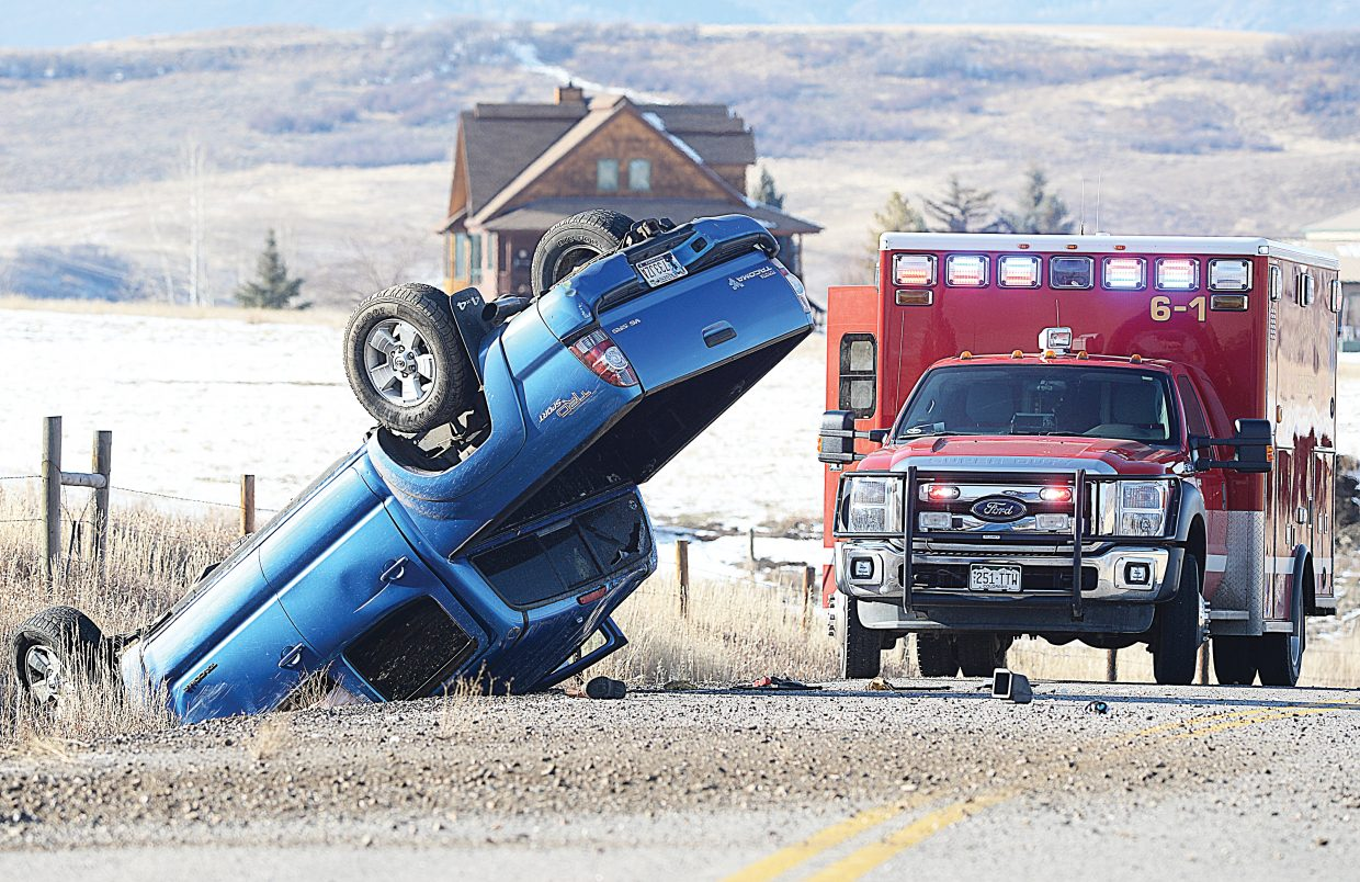 A Toyota pickup truck sits on its roof near the Wolf Run Ranch Friday after roll over crash on Routt County Road 33. The driver, the only occupant of the vehicle, walked away from the crash but was checked for minor injuries.