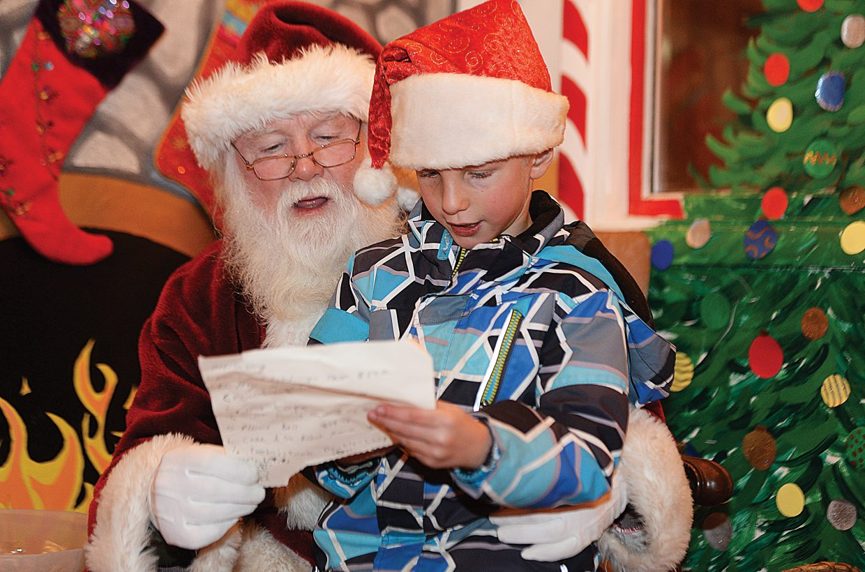 Odin Gruben, 6, had a long list of items to pass along to Santa Clause during Friday's Light Up The Night community tree lighting ceremony ceremony in downtown Steamboat Springs. The even has become the traditional holiday kickoff and always features a visit from the jolly old elf himself.
