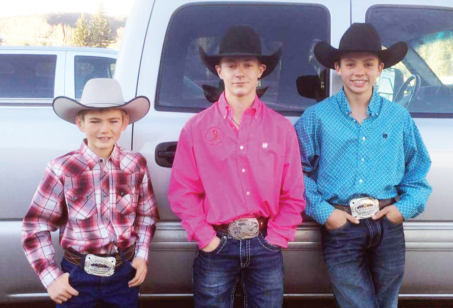 Hayden cowboys, from left, Dorian Hotchkiss, Keenan Hayes and Wyatt Murphy competed at the Heartland Youth Bareback Riding Championships earlier this month.