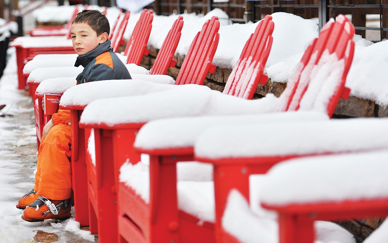 Eight-year-old Jace Rabesa takes a few minutes between runs to relax Wednesday at Steamboat Ski Area.