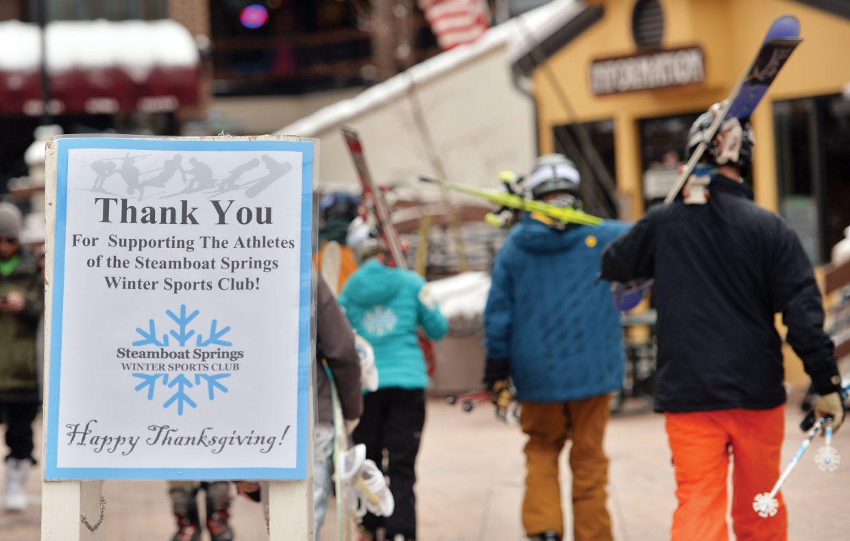 A sign thanks skiers and snowboarders for coming out and supporting the Steamboat Springs Winter Sports Club on Scholarship Day.