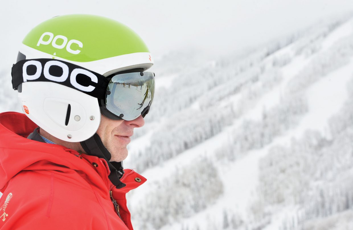 Skiers and snowboarders, including Dane Freckleton, are reflected in Jon Freckleton's goggles as he waits to take his first run of the season at Steamboat Ski Area, which opened Wednesday.
