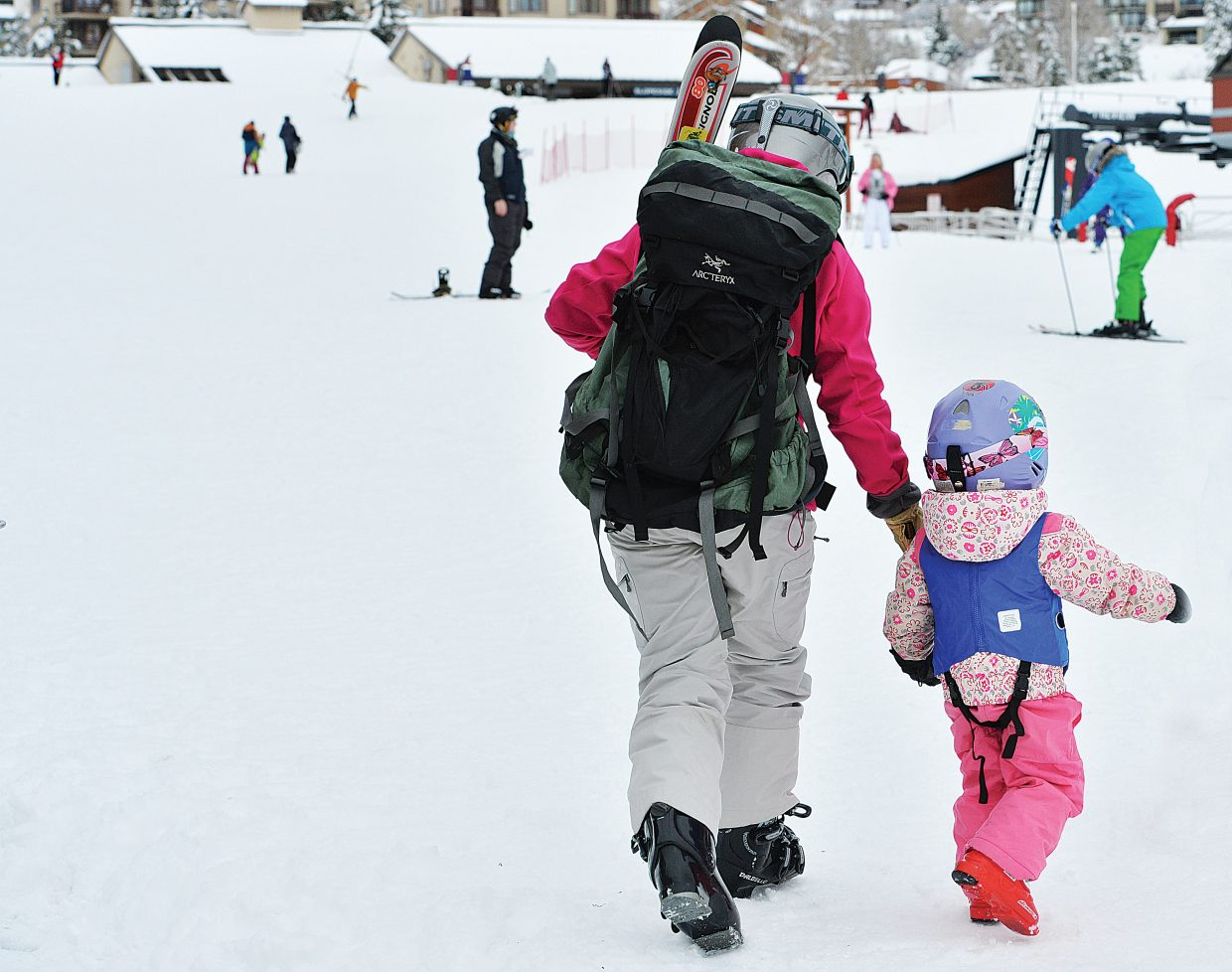 Cecily Townsend, and her daughter Emily head for the Christie Peak Express on Wednesday morning during Scholarship Day at Steamboat Ski Area. The proceeds from ticket sales Wednesday were donated to the Steamboat Springs Winter Sports Club's scholarship program.