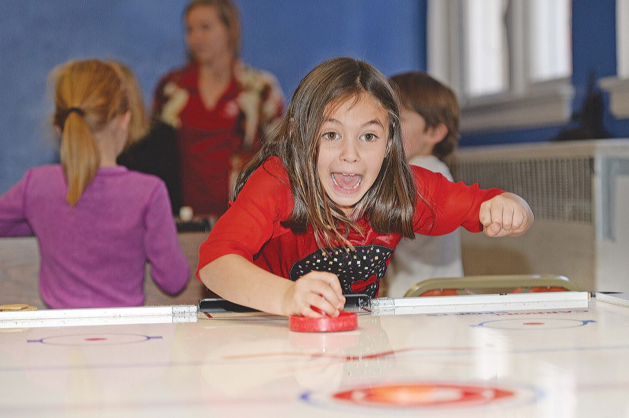 Ava DelHierro returns a shot while playing a game of air hockey at the Boys & Girls Club of Steamboat Springs on Tuesday. The club reached a milestone earlier this month after signing up its 2,000th member.