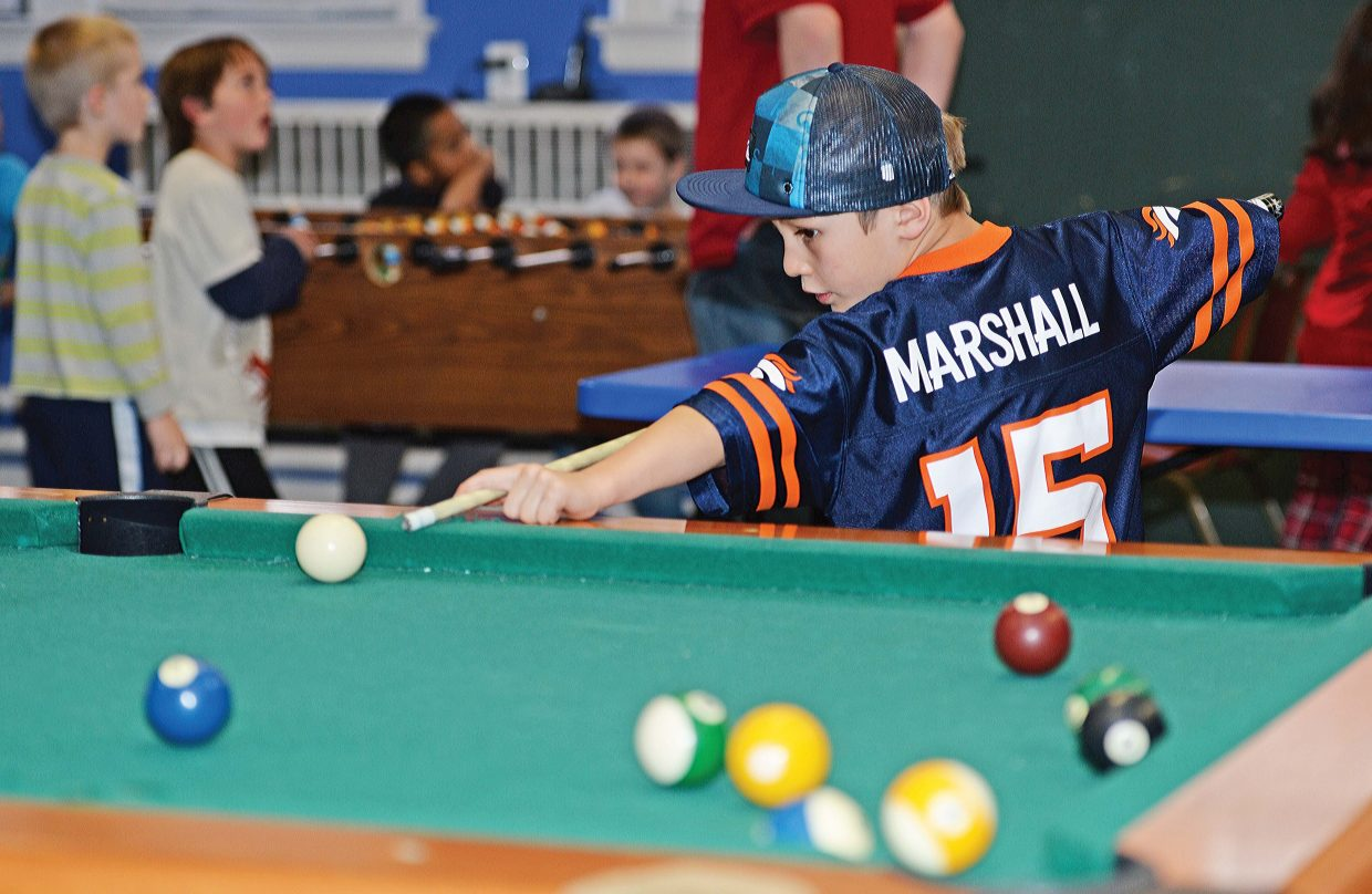 Mateo Rodrigues plays pool at the Boys & Girls Club of Steamboat Springs on Tuesday. The club celebrated a milestone earlier this month after signing up its 2,000th member.