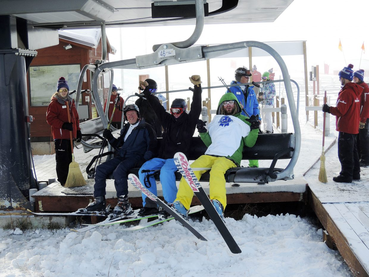 Skiers ride up the first chair on the Christie Peak Express lift Wednesday morning.