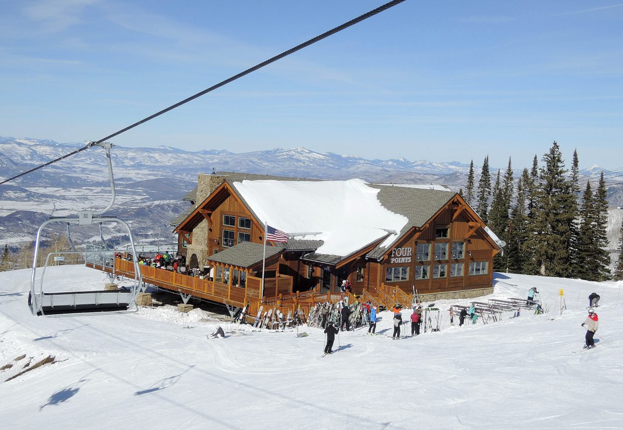 Skiers take a break and check out the new Four Points Lodge on Wednesday.