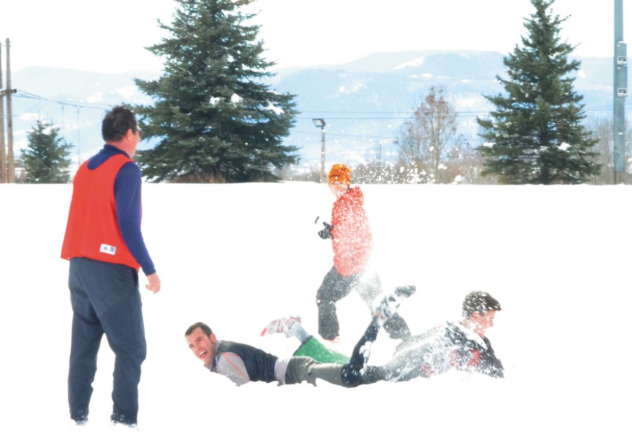 Tom Krabacher goes down in the snow during the fifth annual Turkey Bowl at Ski Town Fields on Thanksgiving Day.