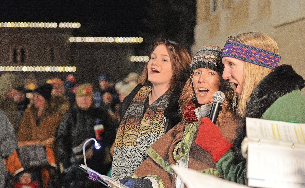 """Members of the Jewel Singers, from left to right, Makayla Woods, Chanel Kaughey and Pam Pierce sing Christmas carols during the """"Light up the Night"""" Celebration in downtown Steamboat Springs. The annual holiday event, which also included the Jewel Singers , cookies and cocas and the traditional ping-pong ball drop officially kicked off the holiday season in Steamboat Springs."""