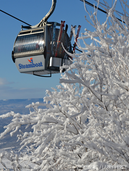 A group of skiers riding the Steamboat gondola are treated to mid-winter scenery Friday as they approach Thunderhead Summit.