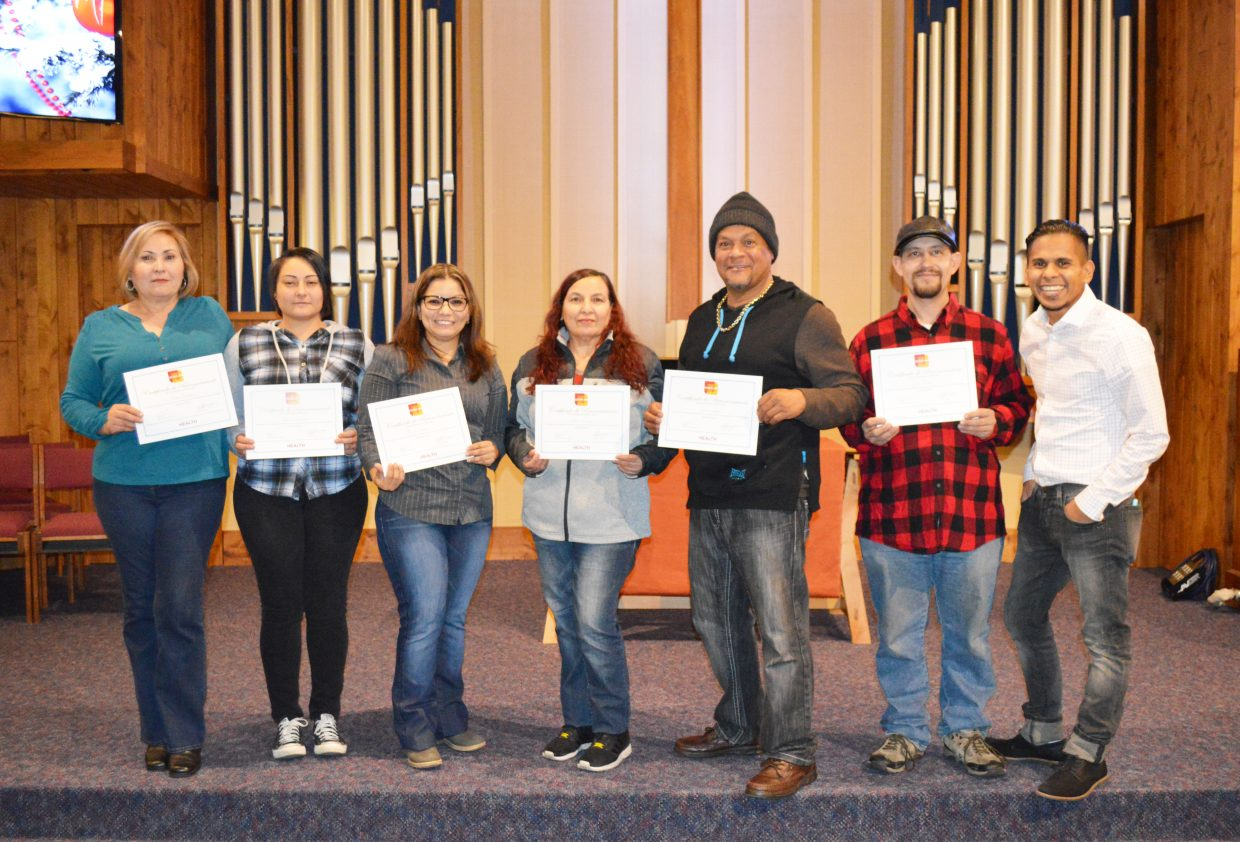 Erick Ocampo, far right, community connector for Northwest Colorado Health, poses with recent graduates of the CHARLAR program, which aims to educate Latinos about preventative healthcare.