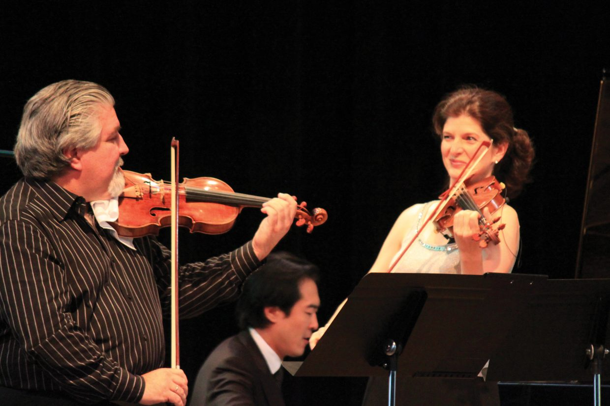 Strings Music Directors Andres Cardenes, left, and Monique Mead will say goodbye to the music festival at the end of the 2014 concert season.