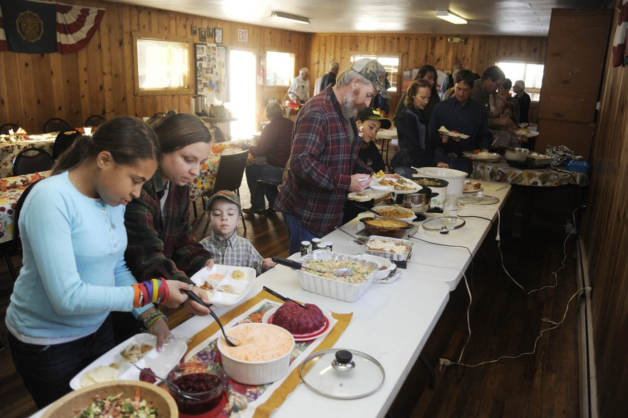 Hayden residents load up their plates during the fourth annual Hayden Thanksgiving Dinner on Thursday at the American Legion Hall.