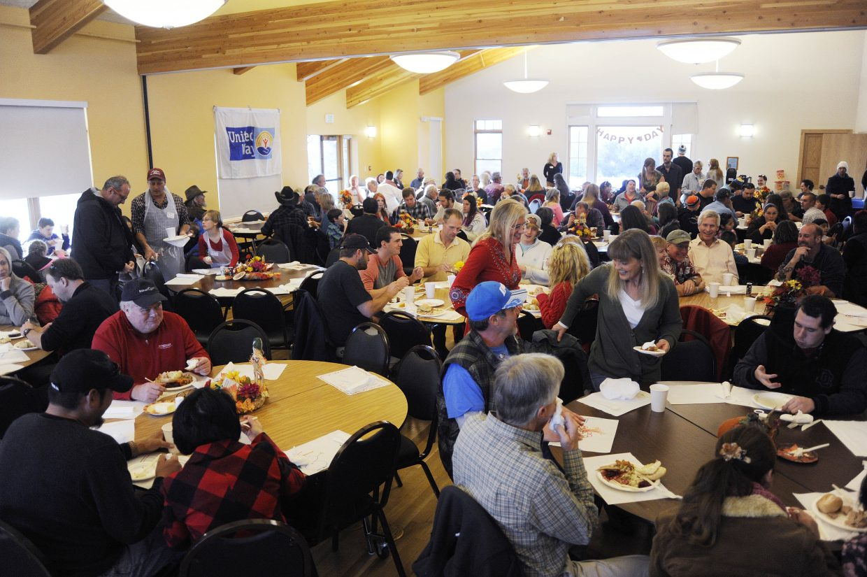 Residents and visitors fill the Steamboat Springs Community Center during Thursday's Routt County United Way Community Thanksgiving Dinner.