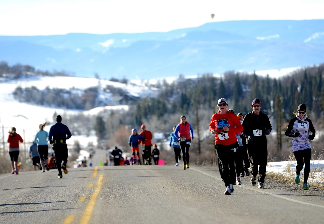 Crowds flock down the course Thursday during the fifth annual Turkey Trot in Steamboat Springs. The event drew about 250 runners out on a brisk but beautiful morning in Steamboat.
