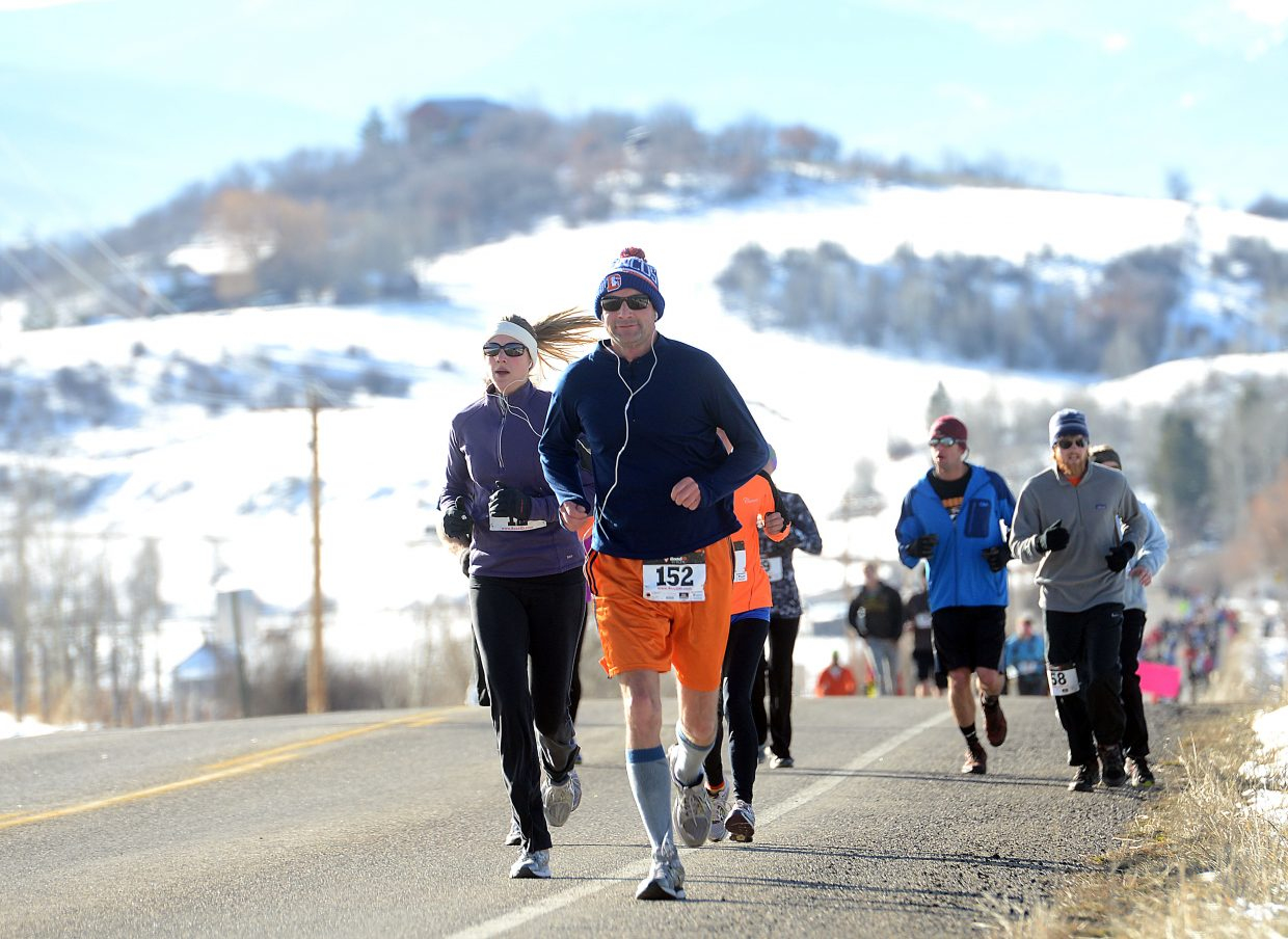 Jim Graeber leads a huge pack of runners Thursday during the Turkey Trot in Steamboat Springs.