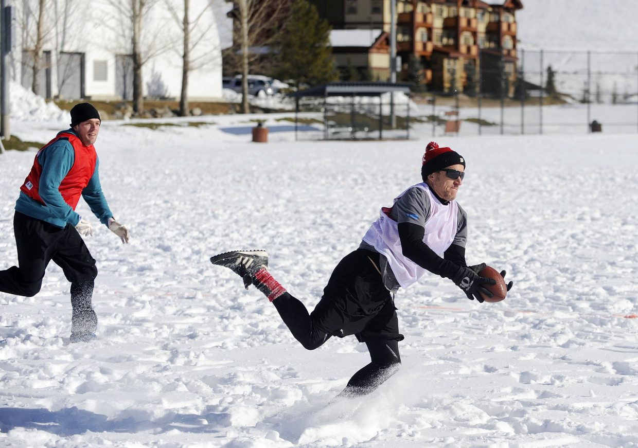 Brent Pearson catches a pass during the annual Turkey Bowl on Thursday at Ski Town Fields.
