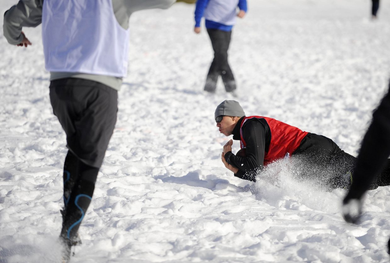 Scott Kempers makes a catch during the Turkey Bowl on Thursday at Ski Town Fields.