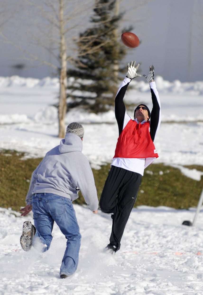 Pete Meyer goes up for a catch during the Turkey Bowl on Thursday at Ski Town Fields.