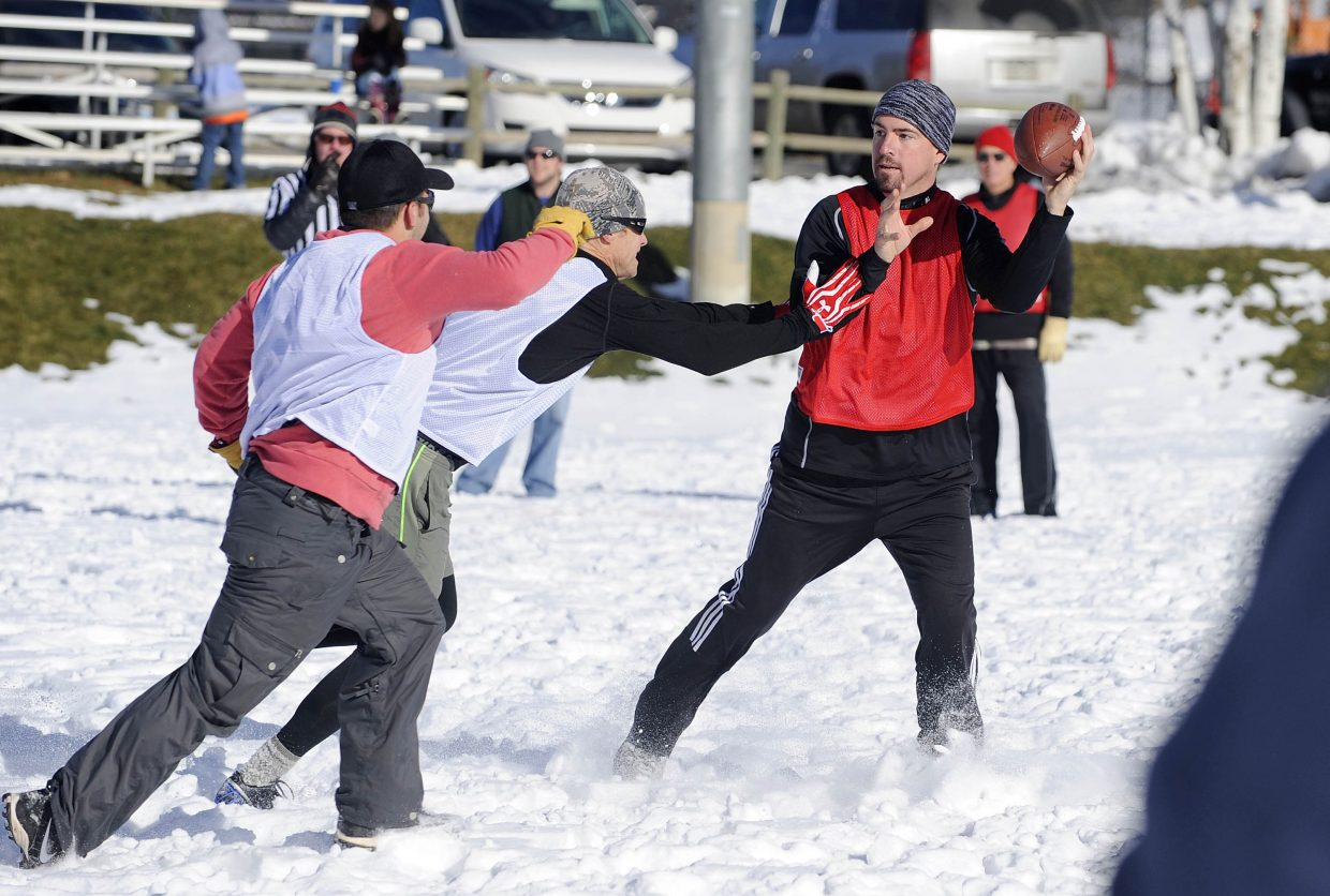 Jeff LaRoche looks for an open teammate during the Turkey Bowl on Thursday at Ski Town Fields.