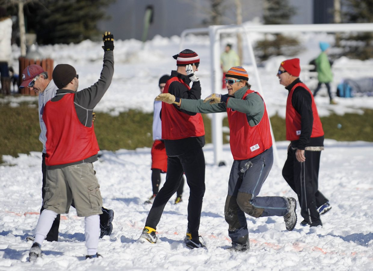 Andy Picking celebrates after scoring a touchdown during the Turkey Bowl on Thursday at Ski Town Fields.