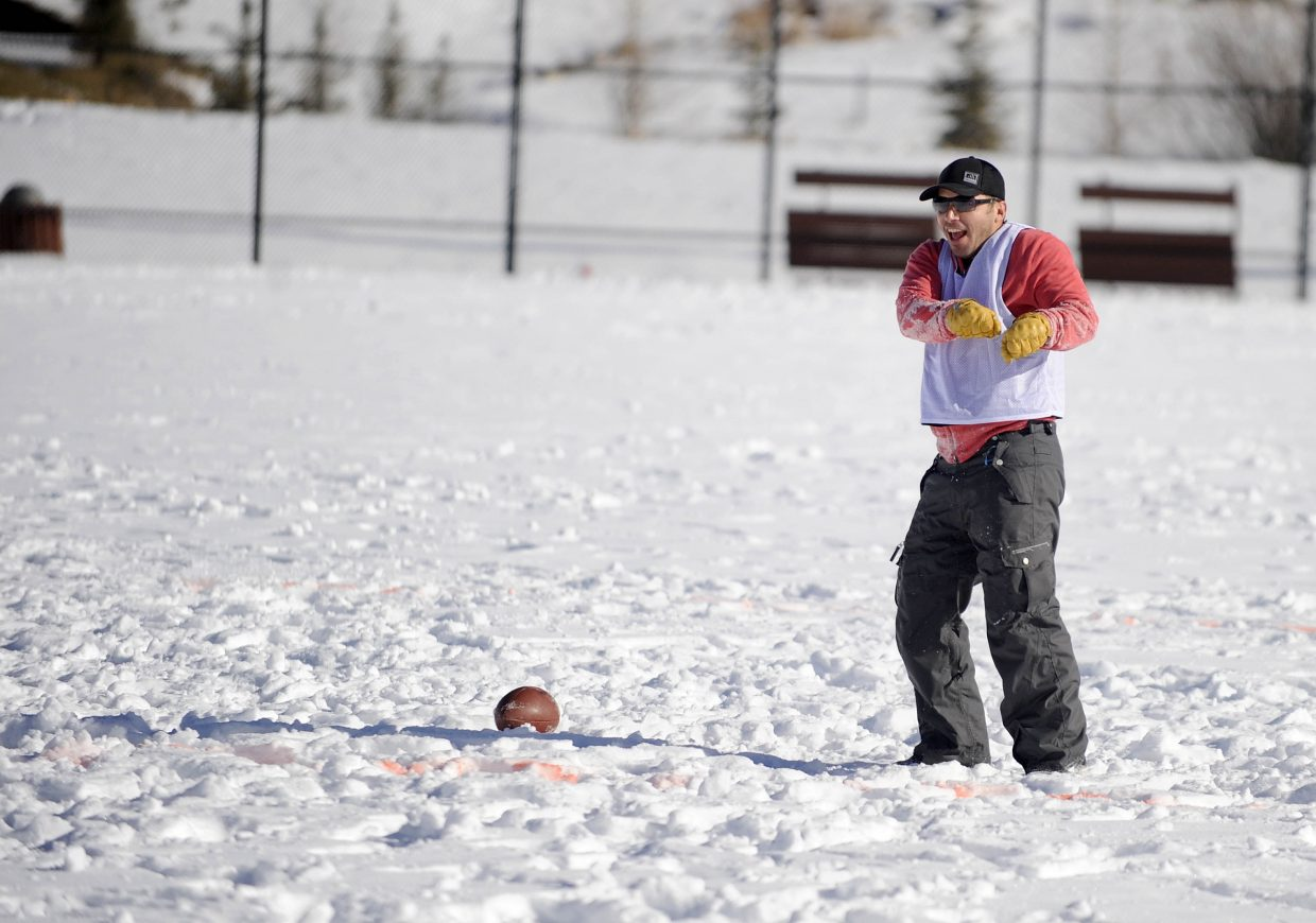Steve Paoli celebrates after scoring a touchdown during the Turkey Bowl on Thursday at Ski Town Fields.