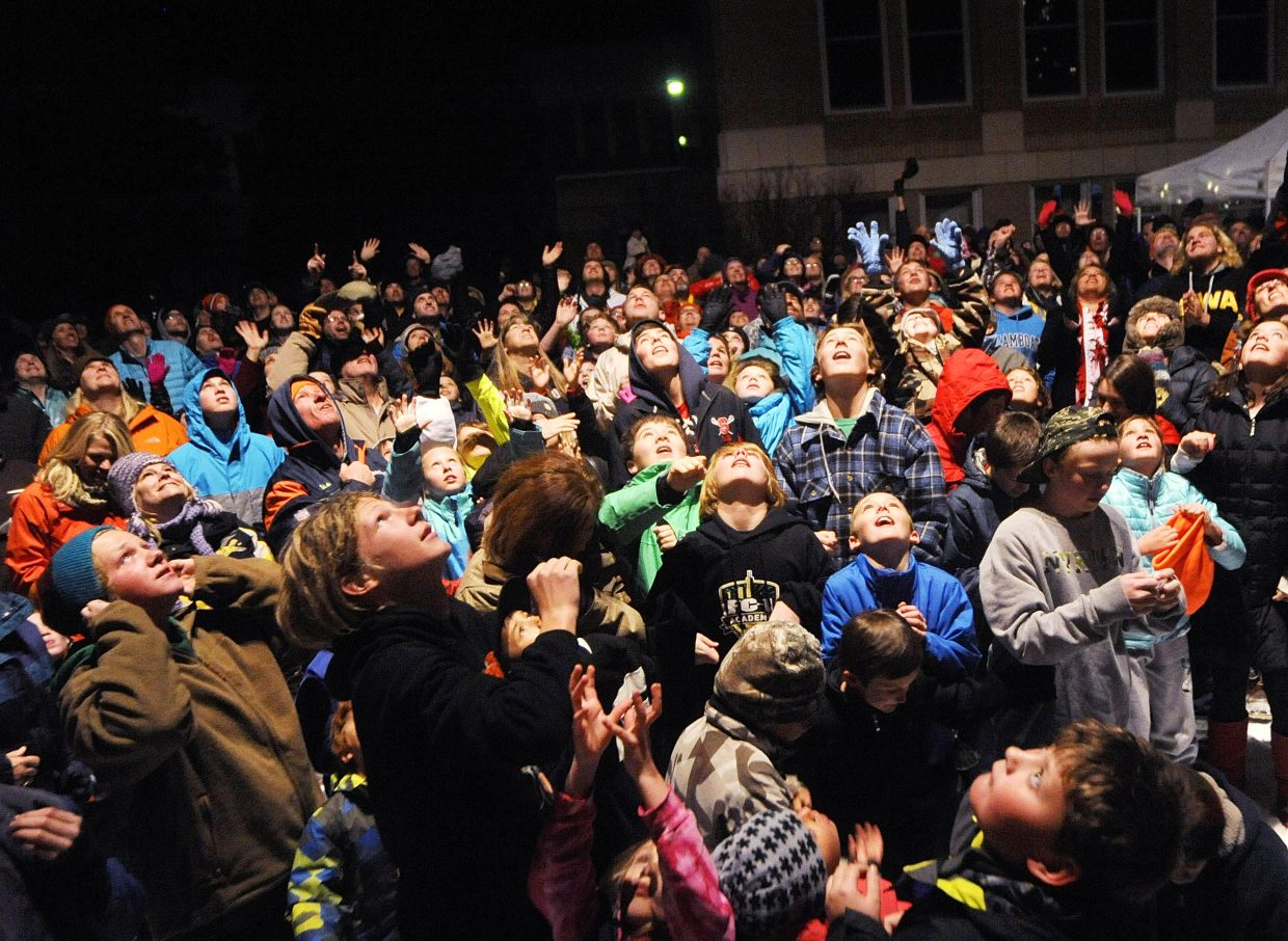 People gather to catch ping-pong balls filled with prizes during the Light up the night community tree lighting event Friday night on the Routt County Courthouse lawn. The event helped kick off the holiday and shopping seasons with visits from Santa, caroling, hot chocolate and cookies.