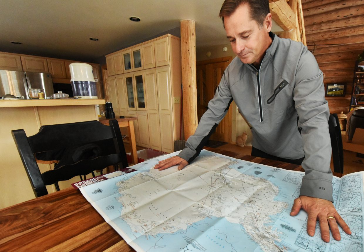 Tumminello surveys a map of Antarctica as he prepares for a trip to ski across the continent.