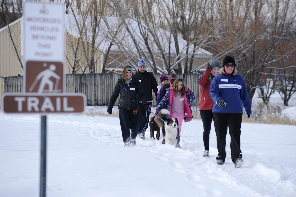 Race participants walk around Dry Creek Park on Saturday during the Turkey Trot 5K and 1-mile fun run.