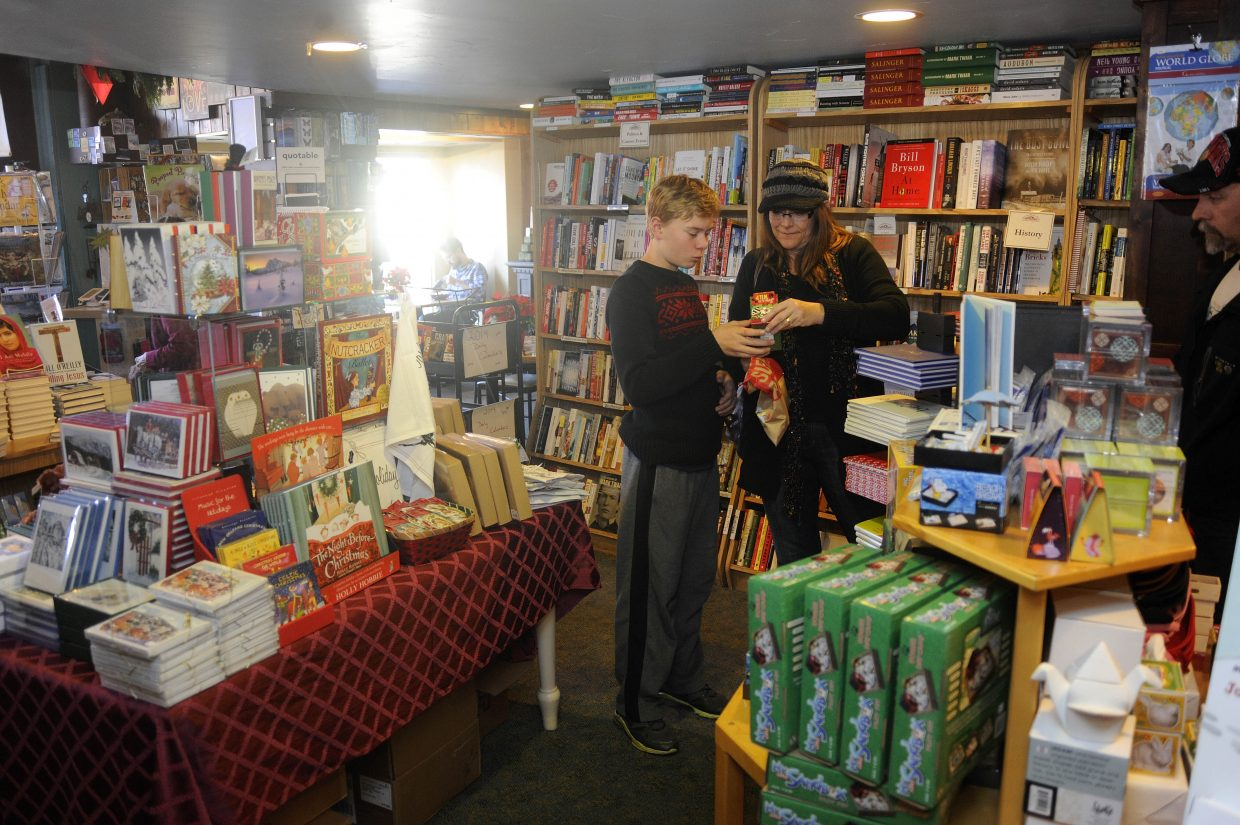 "Shari Johansson and her son Elias do some Black Friday shopping at Off the Beaten Path Bookstore in downtown Steamboat Springs. This Saturday support the local bookstore with ""Small Business Saturday"" and by spending an afternoon with Denver author, Mark Stevens."