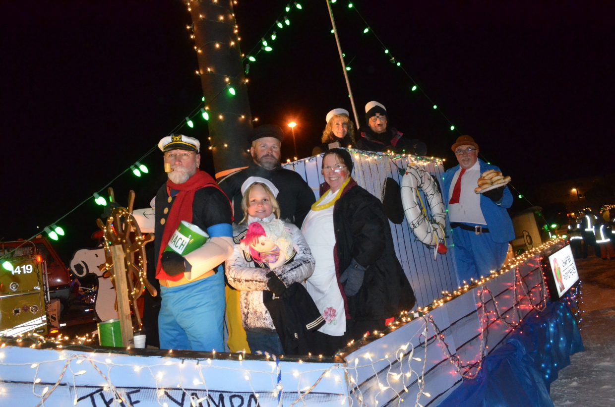 "The members of Northwest Colorado Chapter of Parrotheads gather in their ""Popeye"" costumes on their float, ""The Yampa Olive"" during the parade glow following the Parade of Lights, hosted by Downtown Business Association Saturday night in Craig."
