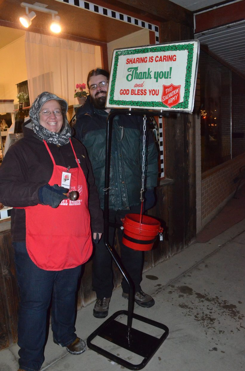 April and Ben Vikse volunteer their time as bell-ringers for the Salvation Army amid Saturday's Parade of Lights. The charitable organization will be seeking donations throughout the month of December leading up to Christmas.