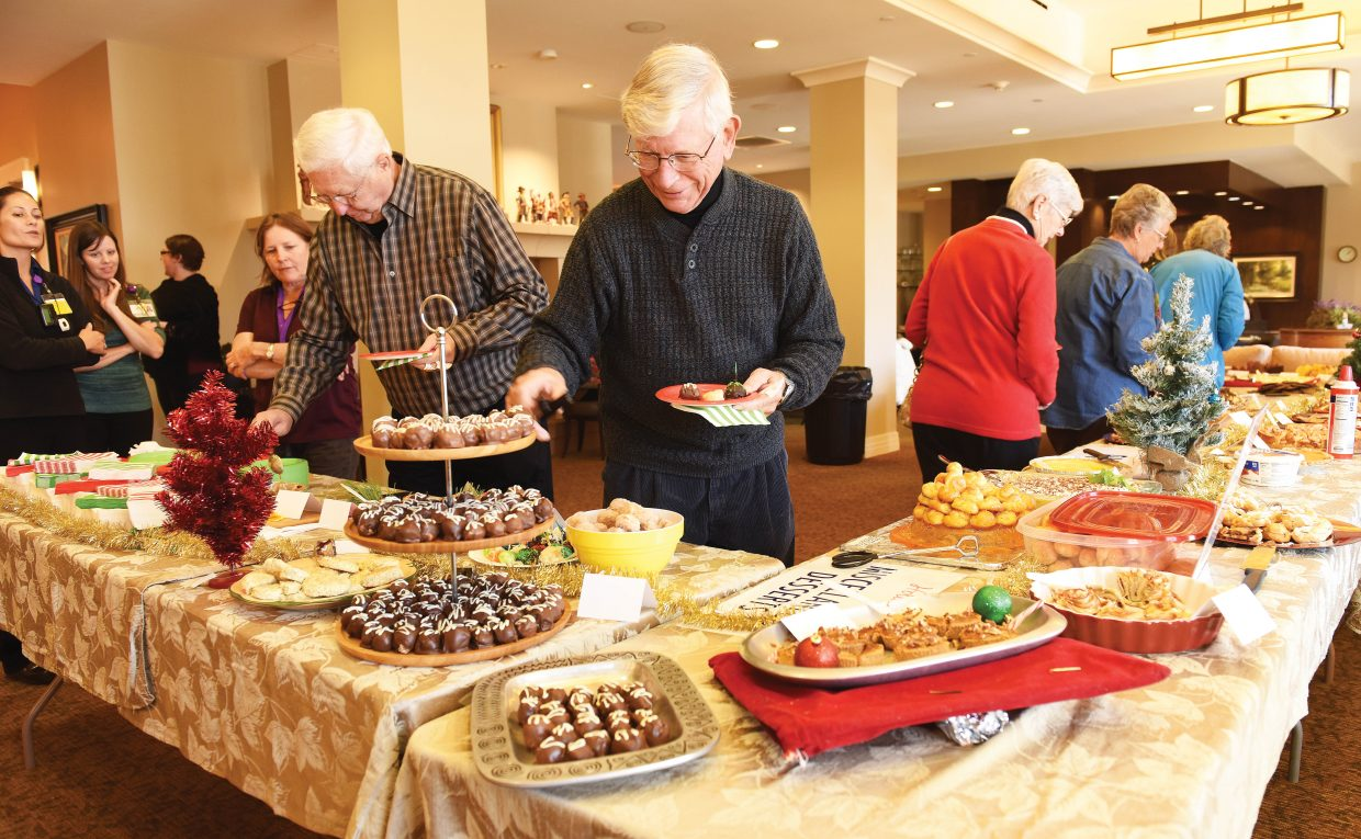 Don Berlinski makes his way through the line at the annual Holiday Dessert Bake-Off at Casey's Pond Monday afternoon. Two hundred people showed up for the opportunity to taste 35 different treats at the annual event, which was sponsored by the Steamboat Pilot & Today and Casey's Pond.