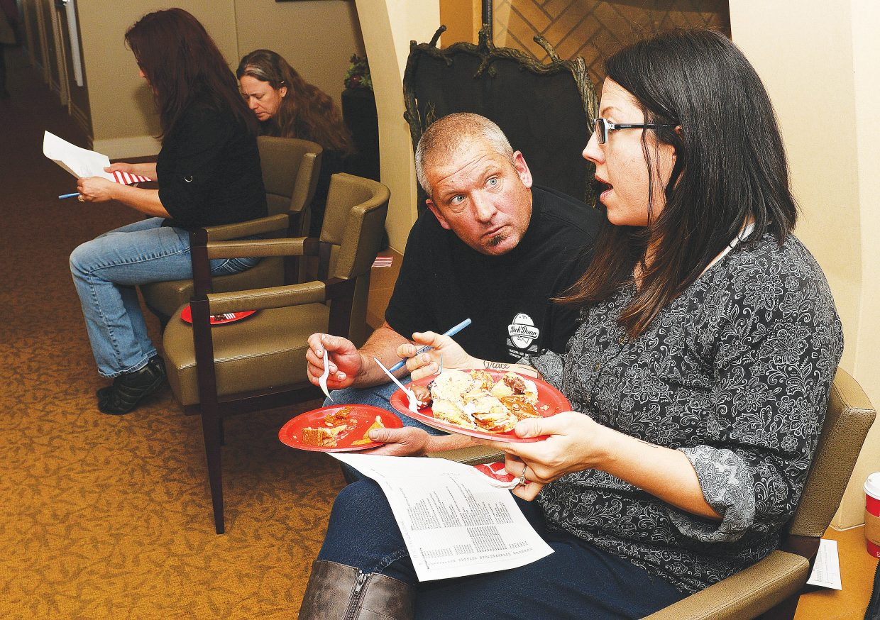 Brandi Eliason and Dave Eliason from Backdoor Grill discuss the entries while judging Monday's Holiday Dessert Bake-off, which was sponsored by Casey's Pond and Steamboat Pilot & Today. Two hundred people showed up for the opportunity to taste 35 different treats.