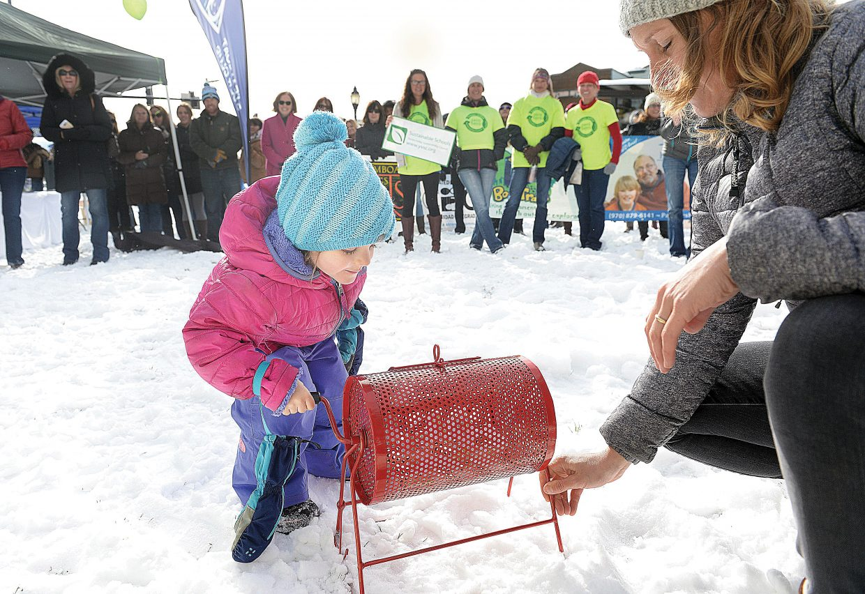 Four-year-old Kelcy Neppl spins a drawing drum as part of the Yampa Valley Gives kick-off party Friday morning on the Routt County Courthouse lawn. The event was held to raise awareness of Yampa Valley Gives Day, which will take place Tuesday, Dec. 6. The local day of giving is held in conjunction with Colorado Gives Day. Community members can go to yampavalleygives.org and donate online to local nonprofits on that day.