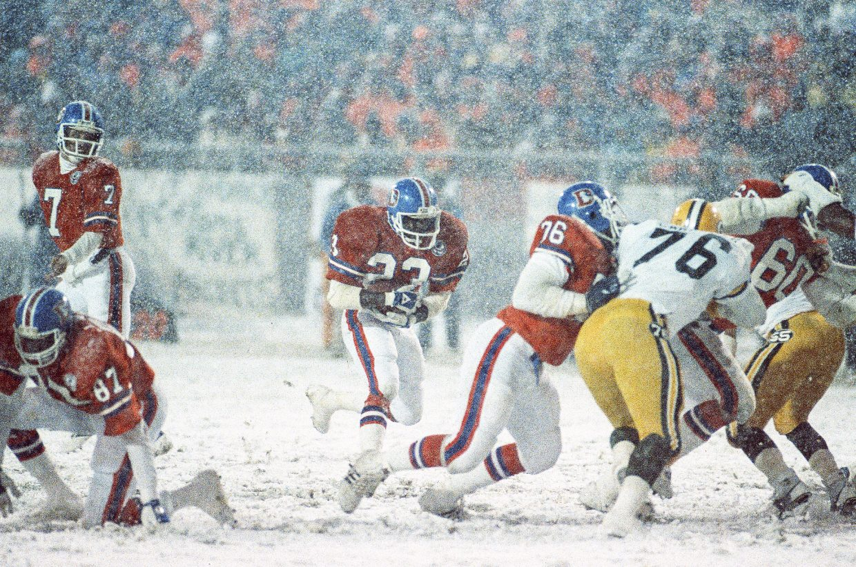 Former Denver Broncos running back Sammy Winder runs through a hole in the Green Bay Packers' defense after taking a handoff from quarterback John Elway during the Oct. 15, 1984, Snow Bowl game. Steamboat resident Rod Hanna was on the sidelines as the Broncos' official photographer and well understands the boost a snowy game in Denver can provide the Colorado ski industry.