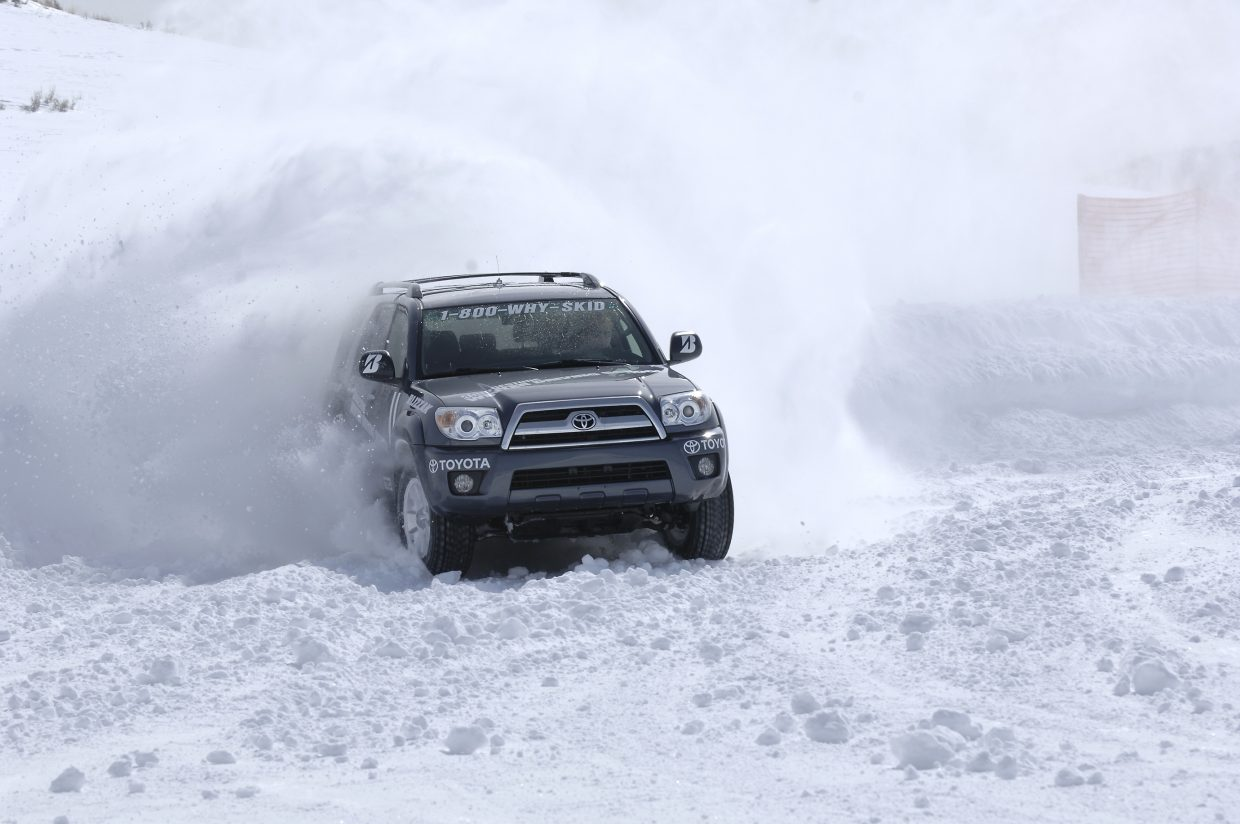 Mark Cox, director of the Bridgestone Winter Driving School, blasts through heavy snow at the driving course just west of Steamboat Springs. In March 2016, Cox drove a more recent model Toyota 4Runner similar to the car in the picture, also in snowy conditions, for a Toyota commercial that aired Nov. 27 during the overtime period of the NFL football game between the Denver Broncos and Kansas City Chiefs.