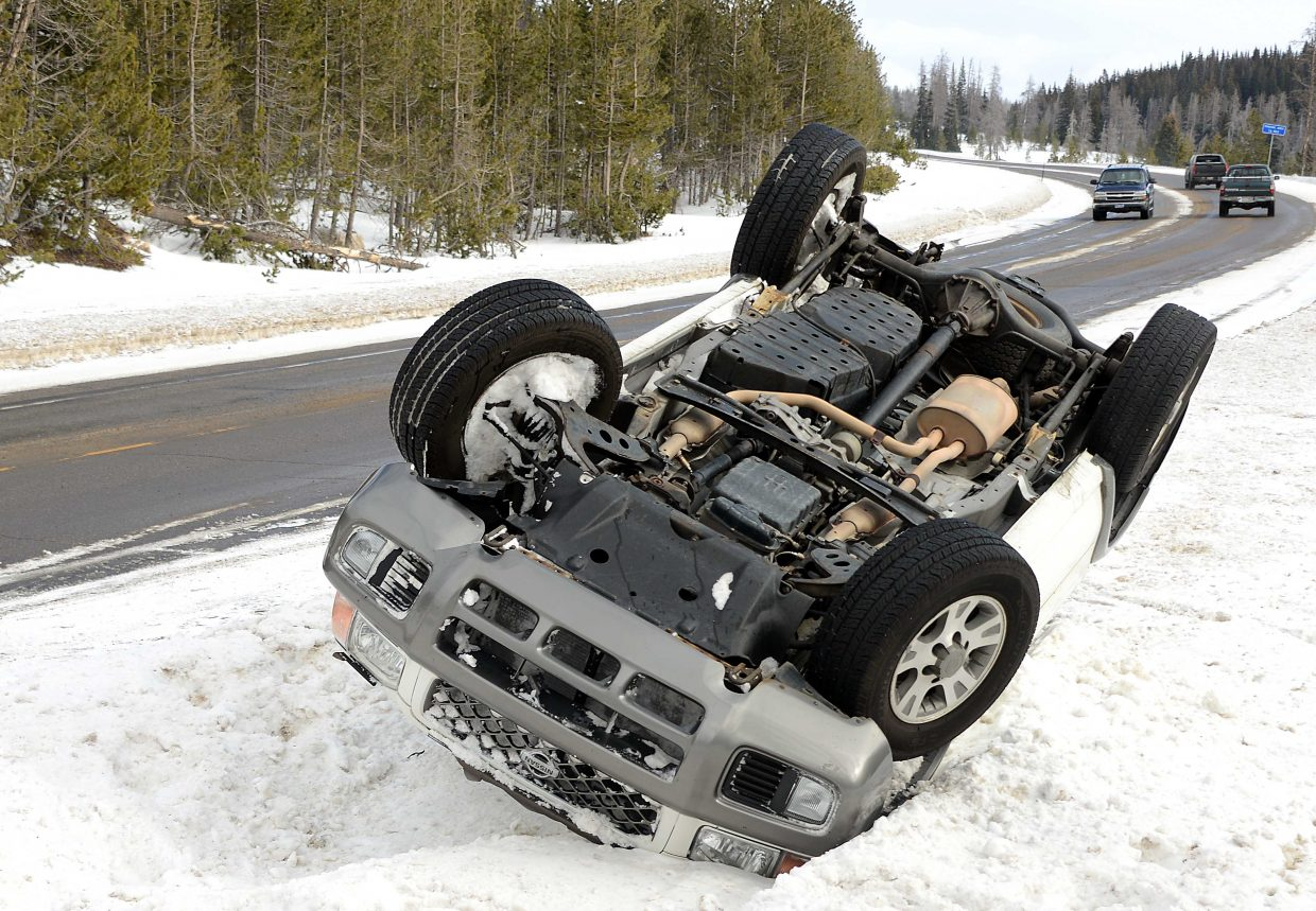 An overturned SUV sits beside U.S. Highway 40 on Sunday morning, one of two rollover crashes on a short span of the highway. Sharon Lynch said she was the driver of the vehicle and had her 9-year-old daughter in the back seat. Lynch said she lost control when she hit a patch of ice. Both were left hanging in their seat belts but were unhurt and were thankful that other drivers stopped immediately to help. A Steamboat Springs Fire Rescue truck already was nearby and was on scene within several minutes.
