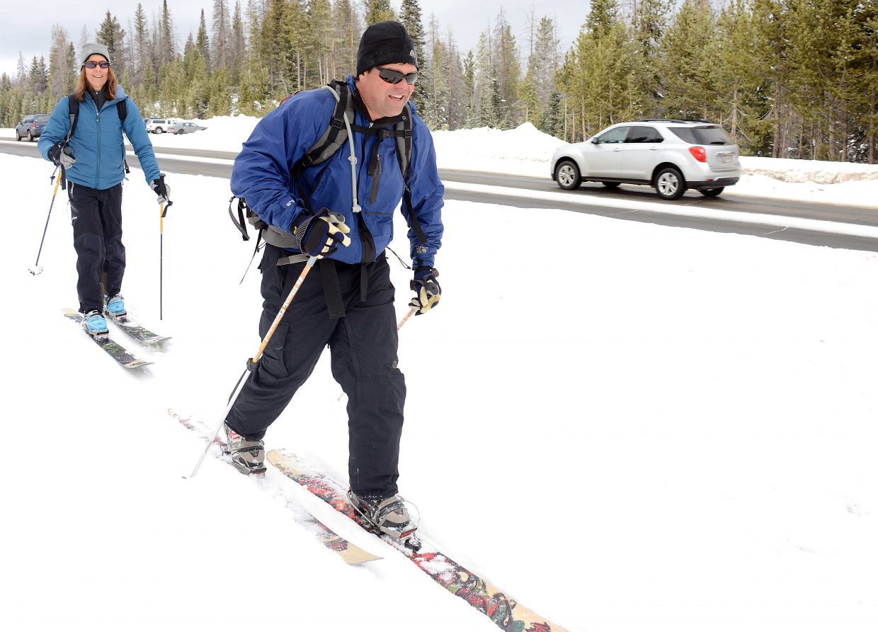Billy Atkinson and Valerie Macdonald make their way into the backcountry from a U.S. highway 40 parking area Sunday morning. With a little fresh snow, Rabbit Ears Pass was a hotbed of activity, facilitating everything from skiers to snowmobilers to Christmas tree hunters.