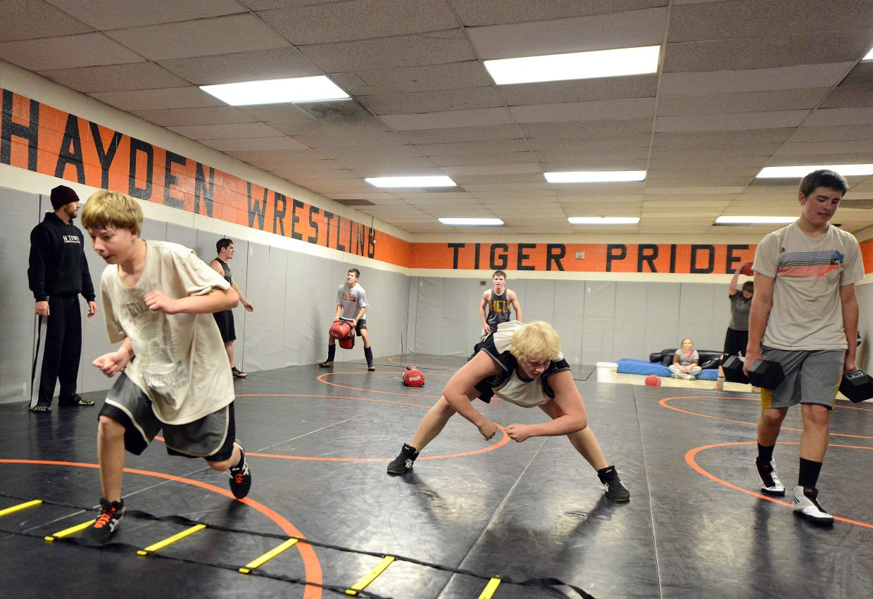 The Hayden High School wrestling team works through an early season conditioning session last week. The Tigers return four of their five state qualifiers from a year ago and, like both Steamboat and Soroco, saw a small surge in numbers this season.
