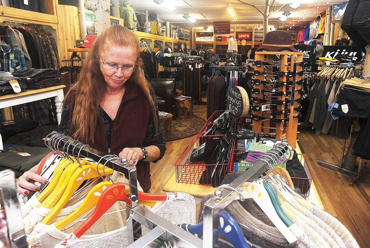 Ellen Becker checks out the merchandise at Allen's Clothing on Monday afternoon while Christmas shopping in downtown Steamboat Springs.