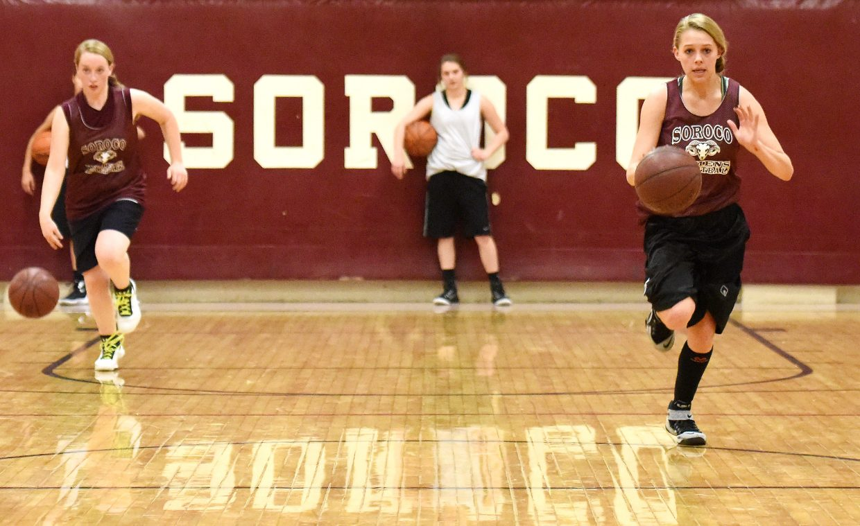 Soroco freshman Justice Sales, right, leads the way down the court during a conditioning drill during basketball practice on Tuesday in Oak Creek. All three local high school girls basketball teams will begin their seasons this weekend, Thursday for Hayden and Soroco and Friday for Steamboat Springs.