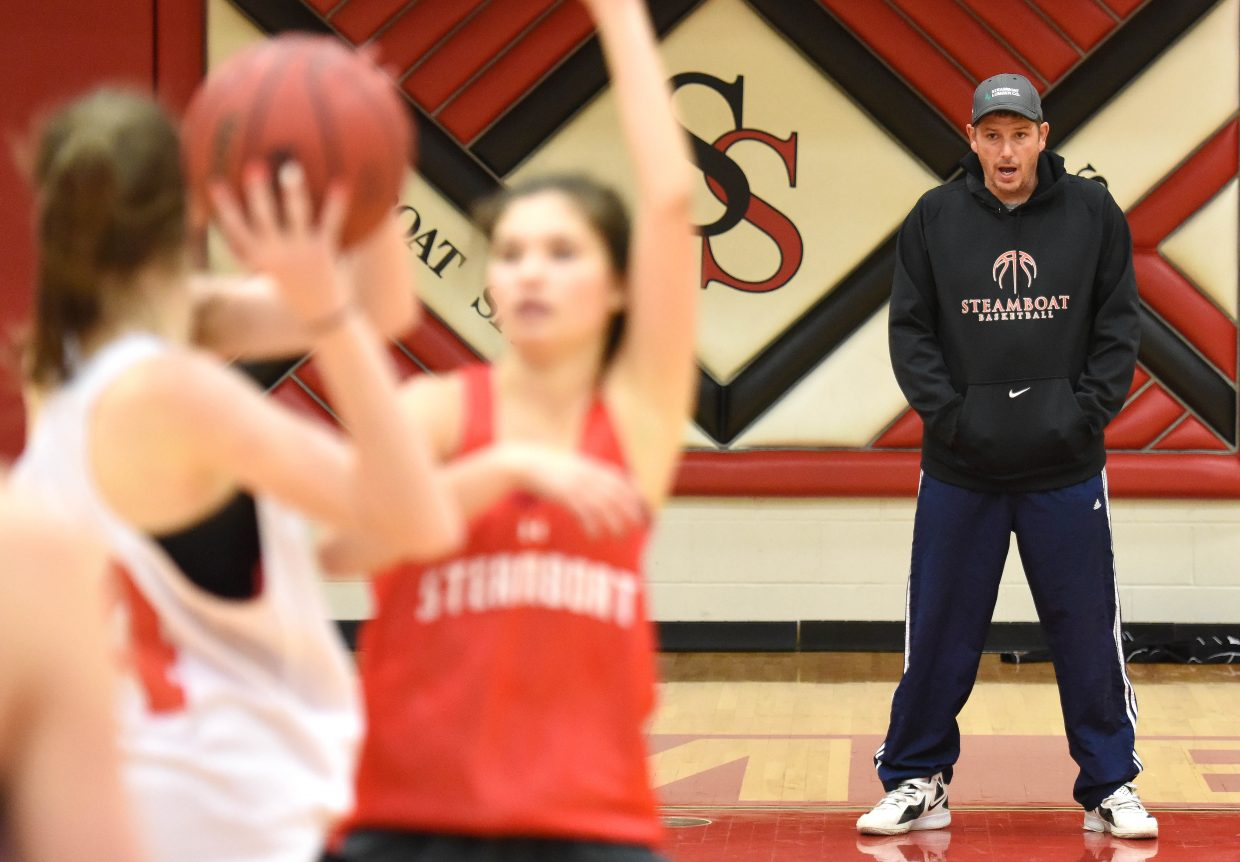 Steamboat coach Mack Spitellie offers some advice during the Sailors' basketball practice on Tuesday.