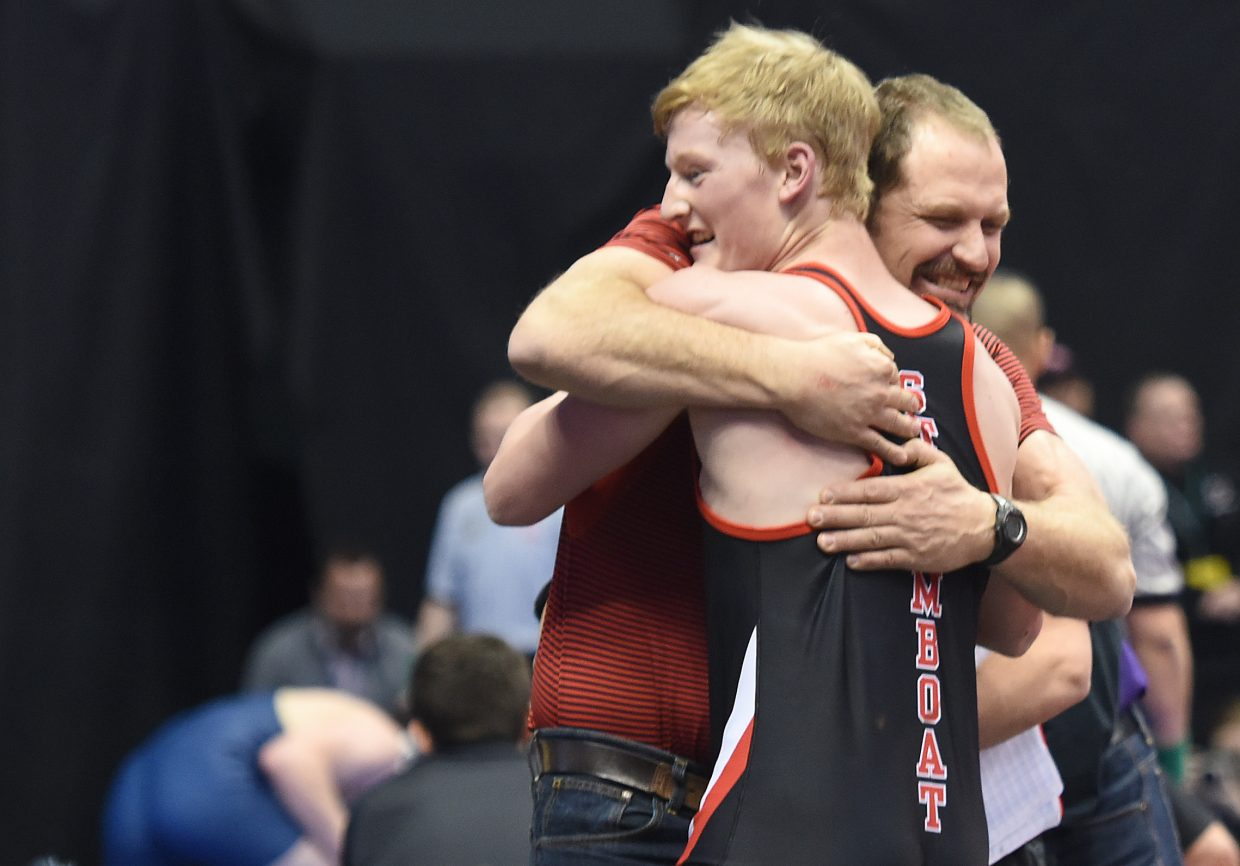 Steamboat coach Travis Bryant celebrates with Hayden Johnson last February after Johnson won a spot in the championship finals at the state wrestling tournament. Johnson's one of three Sailors who qualified for that event who are back to wrestle this season, leading the way for an experienced squad.