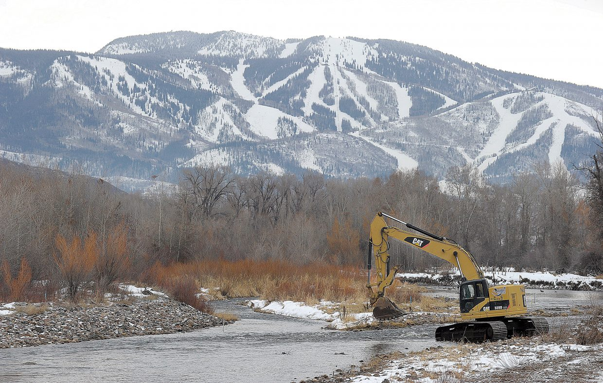 An excavator from Nordic moves into position on the Yampa River Monday morning while working on improvements.